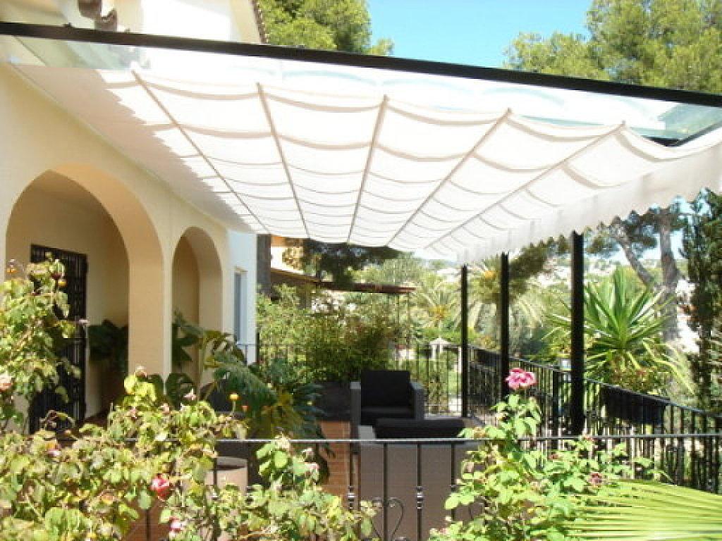 Pergolas toldos en aranjuez - Tendedero de jardin ...
